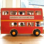 London bus with removable top, decks and people from Lanka Kade